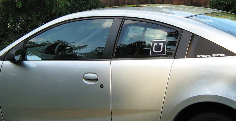 Saturn Ion car with Uber sticker