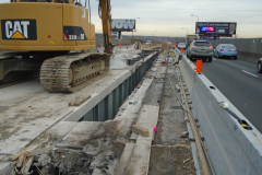January 2020 - Workers remove a section of the bridge's existing concrete deck.