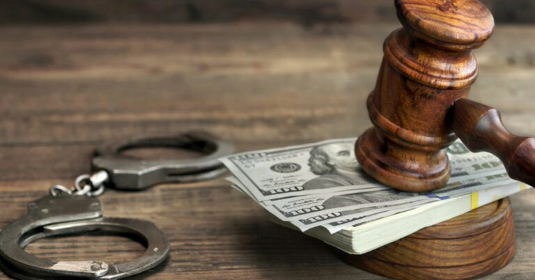 Handcuffs and cash under a judge's gavel