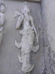 Devata on the ho trai of Wat Phra Singh, Chiang Mai, Thailand.