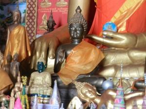 Statues on the altar of Wat Monorom, Luang Prabang, Laos.