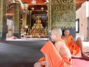 Monks in Wat That Luang, Luang Prabang, Laos.