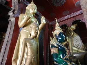 Buddha statues in Wat Mai, Luang Prabang, Laos.