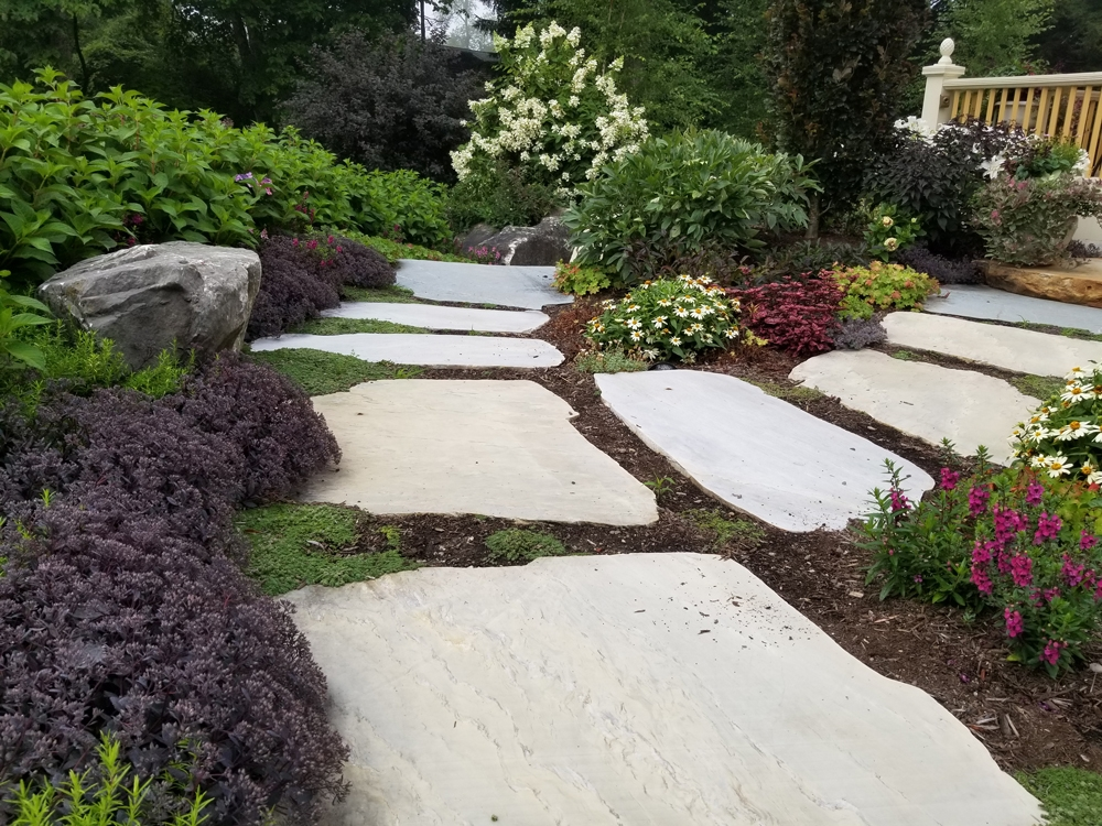 Sliced-limestone-with-sedum-and-annuals