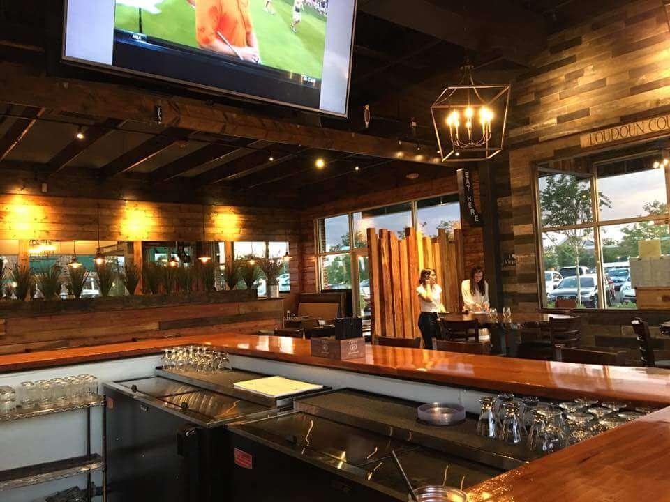 Reclaimed lumber walls and live edge slab bar tops