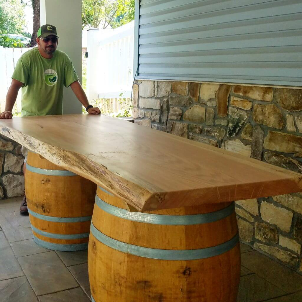 Giant oak live edge slab on reclaimed wine barrels