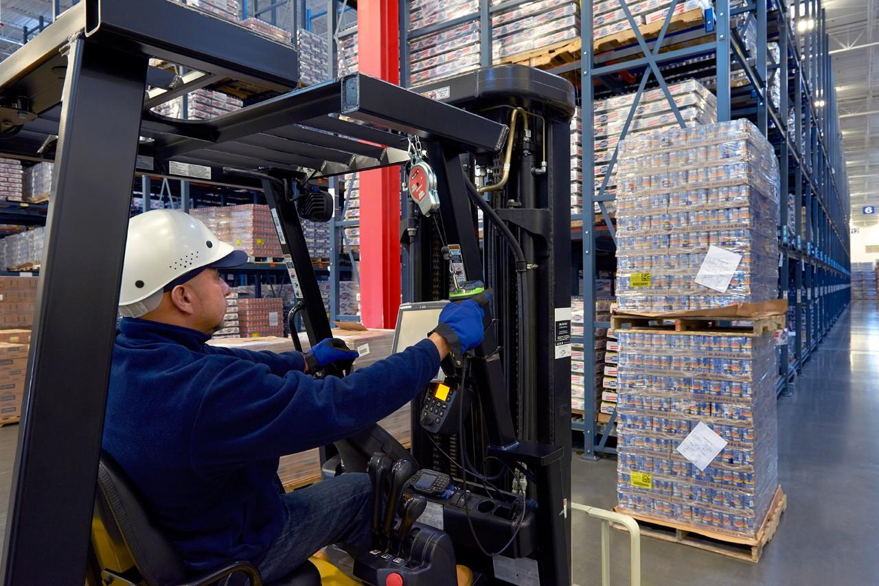 Warehouse Worker Solving Solutions Using a DS3608-HD Ultra-Rugged Scanner to Scan a Pallet