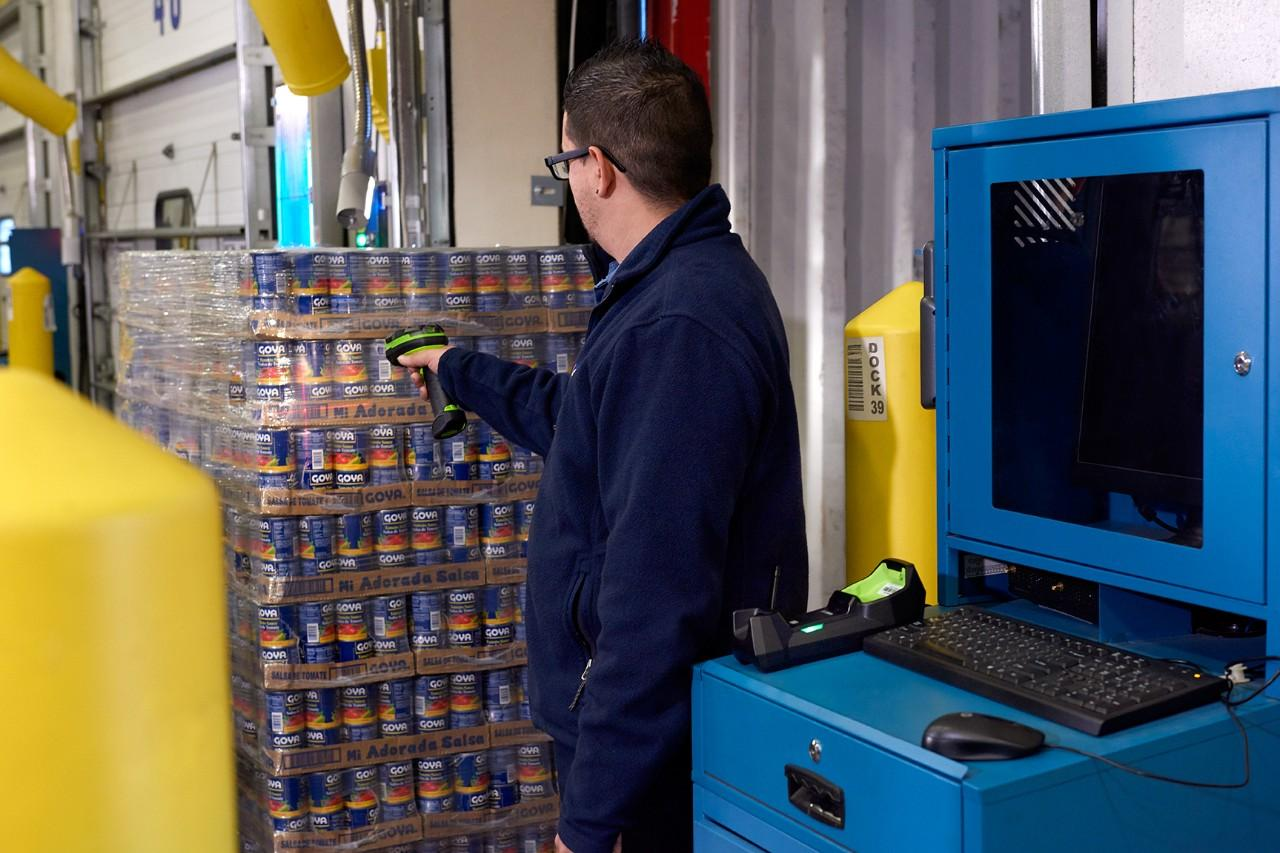 Warehouse Worker Using a DS3678-HP Ultra-Rugged Scanner to Scan a Food Pallet