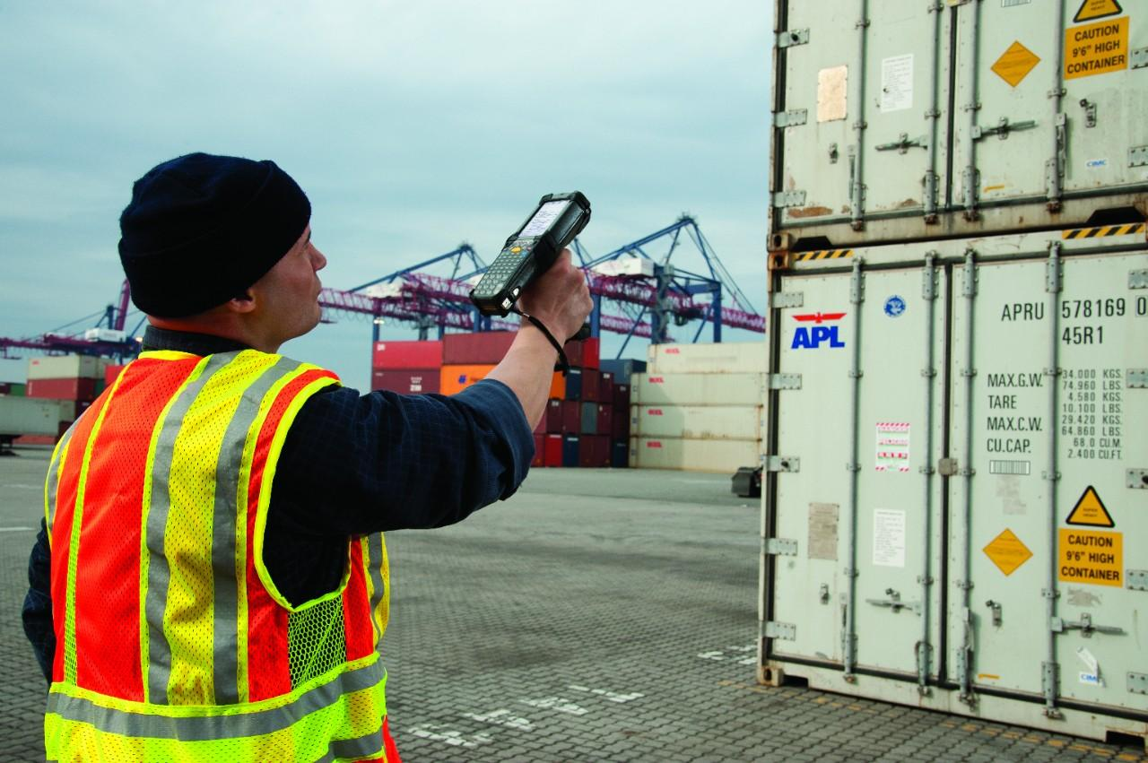 Dock Worker Using MC9190-G to Scan Barcode on Shipping Container