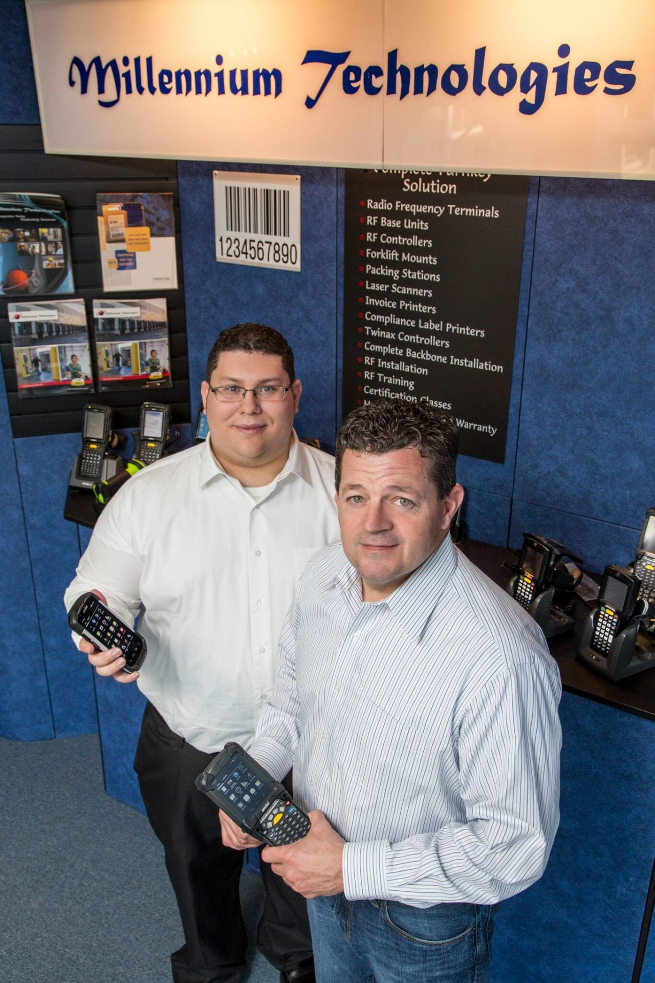 Millennium Technologies Employees holding Mobile Computers and Scanners for Services