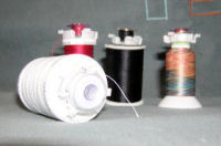 Assorted threads and bobbins