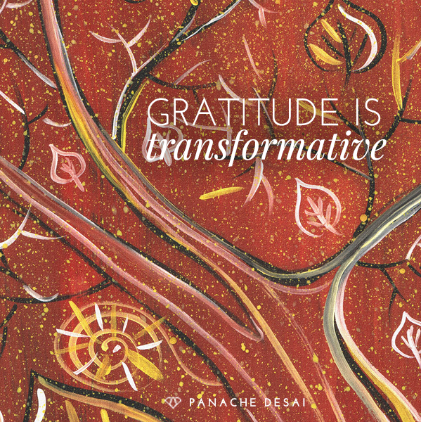 Brown background with swirls of color with words: Gratitude is transformative