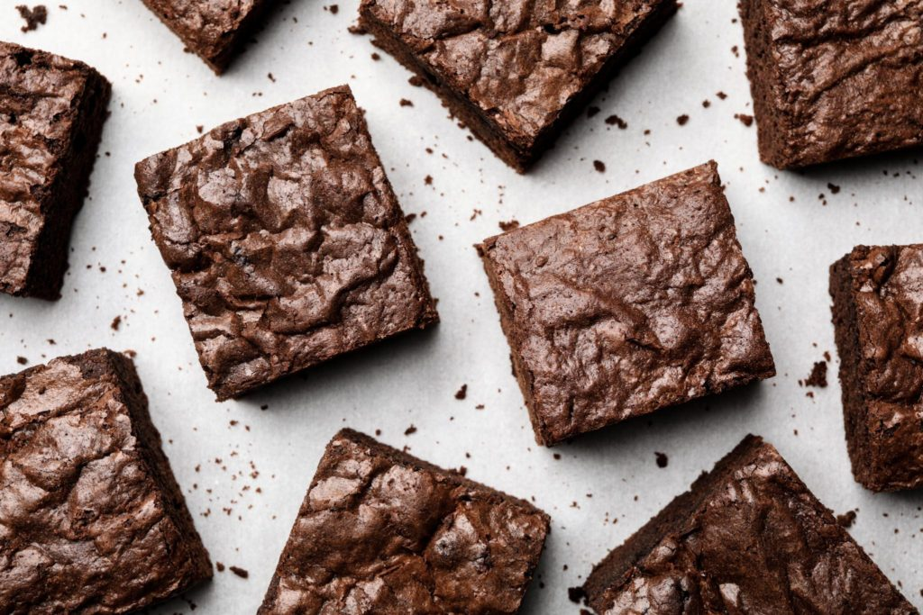 cut brownies displayed on parchment paper