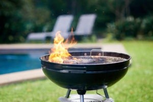 lit charcoal grill with fire