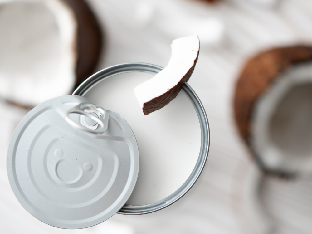 the view of the top of an open can of coconut milk