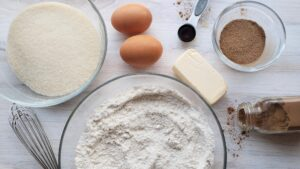 all the raw ingredients for snickerdoodles on a white counter