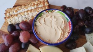 creamy Miyoko's Cheese in a bowl with gluten free crackers
