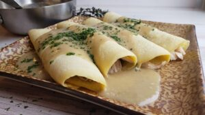coconut flour crepes and gluten-free chicken gravy on a brown plate