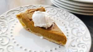slice of gluten free pumpkin pie on a white plate