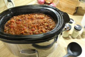 large crockpot full of chili on the counter