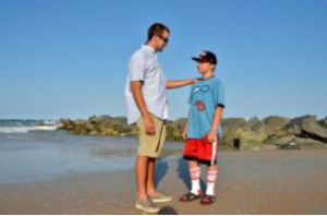 PETER.WILLOTT@STAUGUSTINE.COM Dustan Doucette talks with Austin Wesp, 12, near the Vilano Beach jetty on Wednesday, May 21, 2014. Doucette saved Wesp after a rip tide pulled him far out into the ocean on May 15.