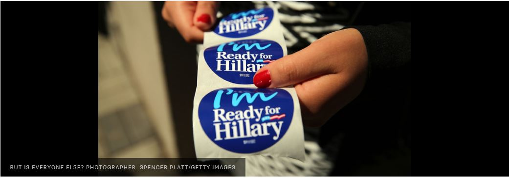"PHOTO OD A ROLL OF CAMPAIGN STICKERS PRINTED WITH THE SLOGAN ""I'M READY FOR HILLARY BEING HELD IN THE HANDS OF A LADY"