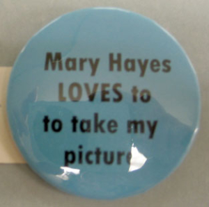 A button issued by the Aspen Times.