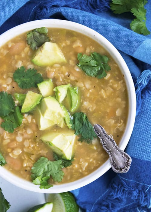 CrockPot Vegan Green Chili Soup is a hearty vegetarian green chili. Top this chili with creamy diced avocado and cool cilantro for the best flavor ever!