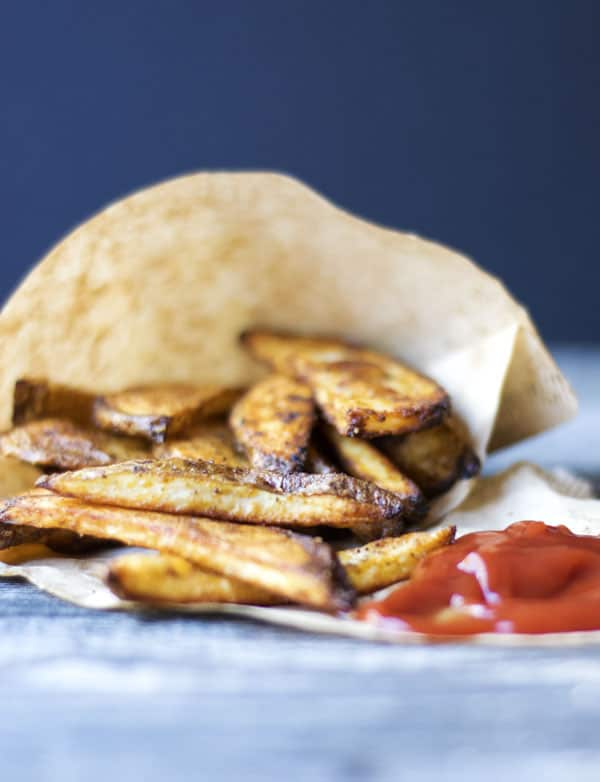 Zesty Oven Fries are a healthy side dish option. They are so easy, and taste way better than those bagged frozen fries!