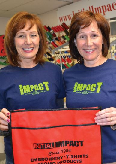 Sisters Donna Szakats (left) and Tammy Greg of Initial Impact are taking PC Skills classes.