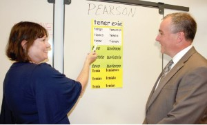 State Labor Commissioner Harold Wirths takes a quick lesson in Spanish from Mercer County Community College instructor Emily Jacobs at a Basic Skills class held at Pearson in Cranbury.