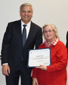 CPT training graduate Cheryllee Nebel proudly displays her certificate with NJ Labor Department Chief of Staff Gary Hasenblag at Rowan College of Gloucester County.