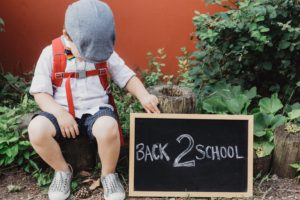 Boy with back to school sign