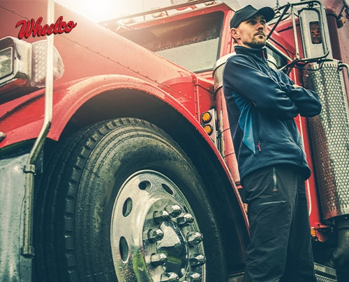 Man Standing with Red Truck