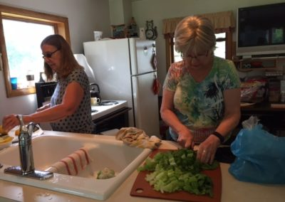 Leah Preston and Susan Knight prepping for dinner