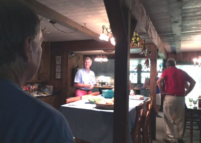 Friday, July 21 at the welcome dinner at Merrianne and Gib McGill's house - Steve Jamison in middle