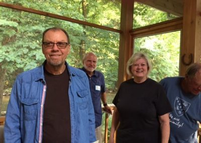 Friday, July 21 at the welcome dinner at Merrianne and Gib McGill's house - From Left - Peter Parr, Ed Pollock, Pam Parr Turner, Ron Pollock