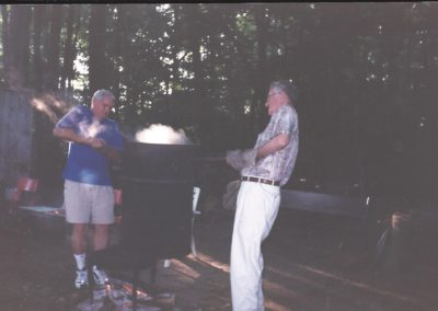 Larry & George lifting the corn off the fire at the annual Stultz Farm Corn Boil