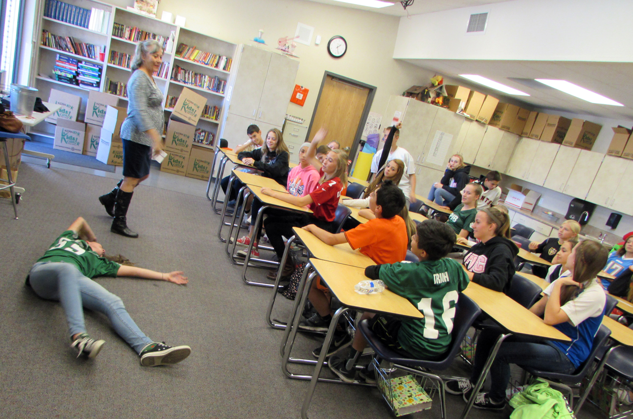 Cathy Bourland with The Center for Violence-Free Relationships works with 7th grade students during TEACH program