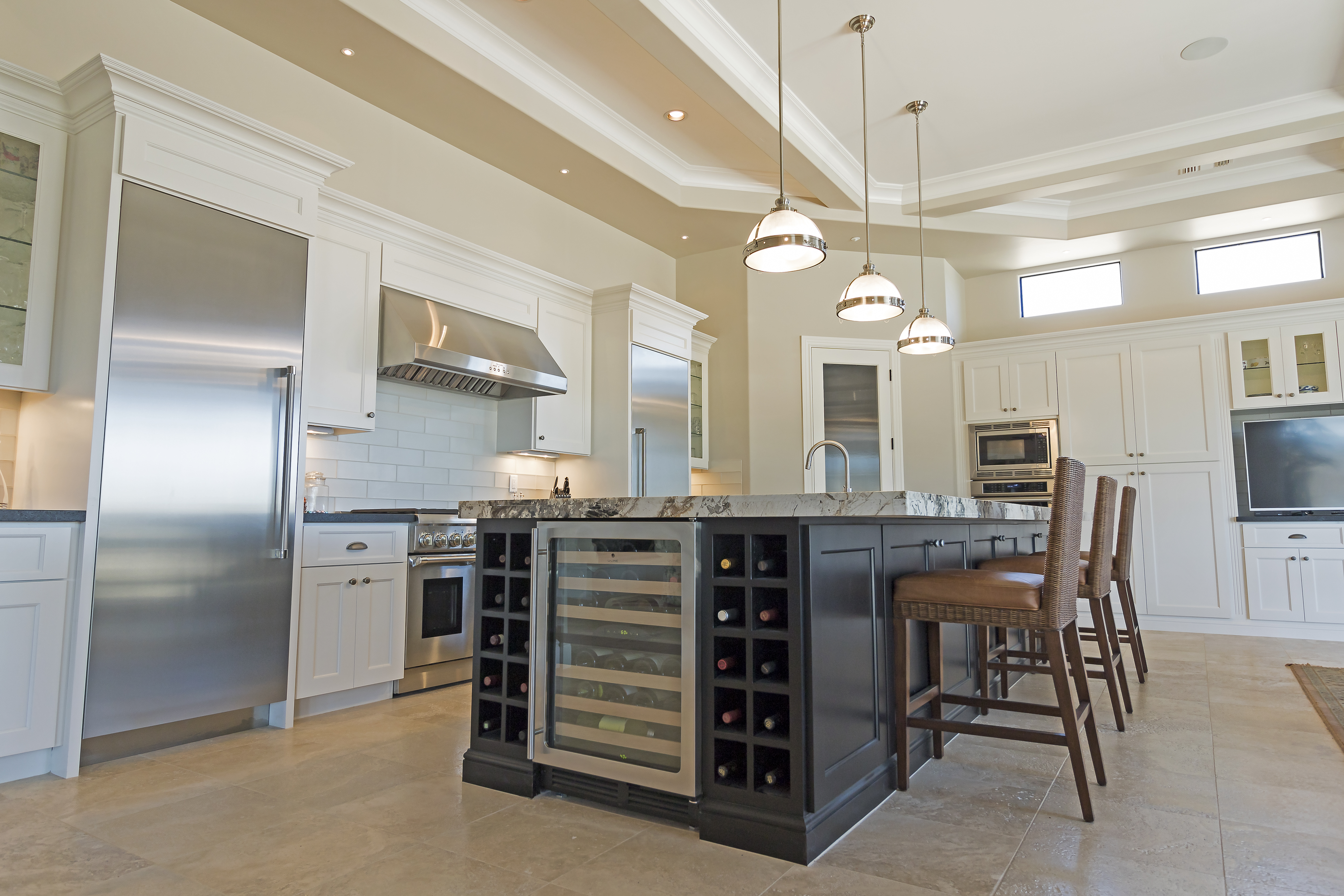 Phoenix Blackstone Custom Home Contemporary kitchen island with wine cooler and storage