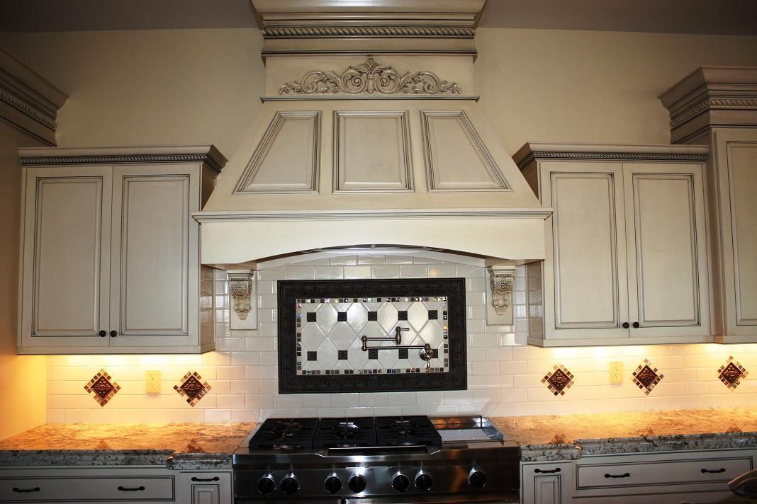 custom kitchen: hood, backsplash, appliances