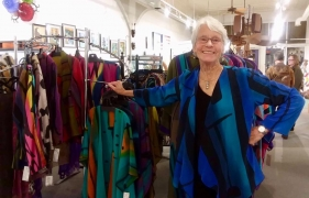 <p>Peggotty in front of her fabulous hand painted jackets.</p>