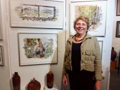 <h5>Artist Bonnie Stauffer next to her brilliant mixed media work</h5>