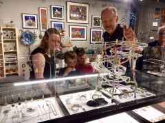 <h5>Bandhu Scott Dunham showing little ones how his new hand blown glass marble sculpture is played</h5>