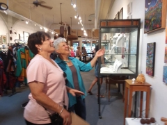 <p>Guests enjoying Marna Schindler's art work.</p>