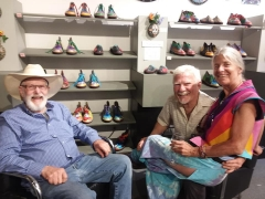 <p>Otto (center) surrounded by friends in our shoe department.</p>