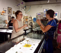 <p>Our jeweler extraordinaire, Lesley McKeown, showing her jewelry to an admiring customer.</p>