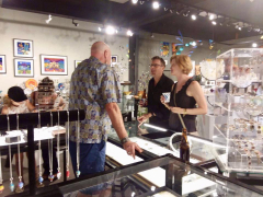 <p>Our John showing Chris Marchetti and friend, Lesley McKeown's jewelry.</p>