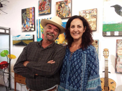 <p>Customers hamming it up in front of Dave Newman's art work! </p>