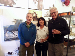 <p>Jody Miller and friends in front of her amazing Equine photography. </p>